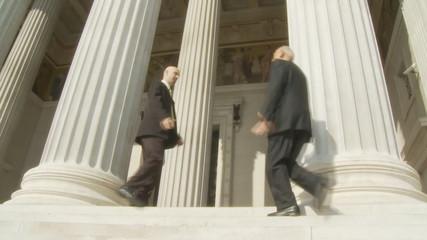 handshake between two businessman meeting on stairs