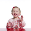 Happy toddler with glass of water