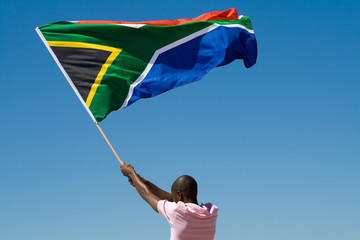 african man waving a south african flag