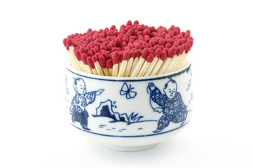 Safety matches in colorful bowl
