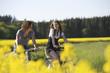 Leinwanddruck Bild - couple biking