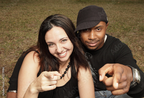 Couple pointing at the camera
