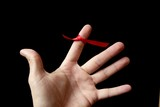 Red tape ribbon, loop tape around human finger poster