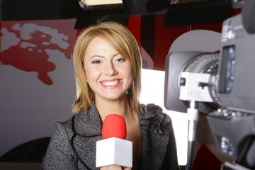 television news reporter and video camera in live transmission