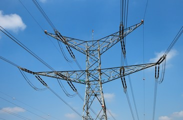 Two-tiered steel support of overhead power transmission line