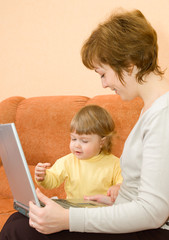 Small girl and mother with laptop