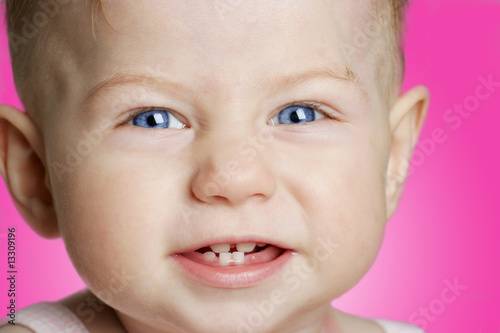 baby girl with blue eyes smiling