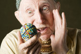 Man contemplating a rubber band ball