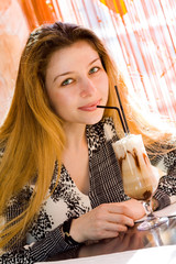 Beautiful sexy woman drinking latte coffee