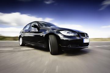 Black Car In Motion