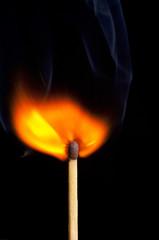 Burning vertical matchstick