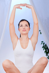 Young pretty woman at yoga relaxation