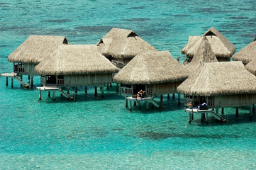 luxury overwater bungalows at blue lagoon in French Polynesia