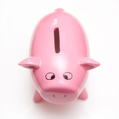 Piggy bank style money box on a white studio background.