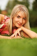 Beautiful young woman on green grass
