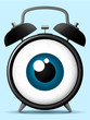 Classic alarm clock with staring eyeball