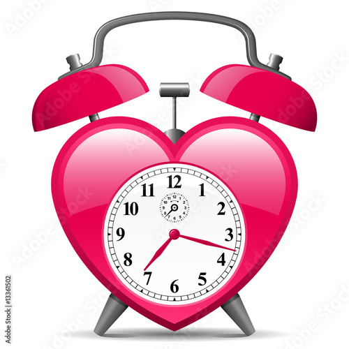 Classic alarm clock in heart shape