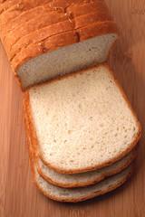 Sliced white bread on cutting board