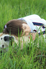 Girl and dog in grass