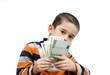 Cute little boy hides behind a fan of banknotes