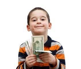 Cute little boy holds a fan of banknotes