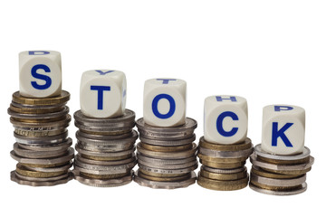 Stacks of coins with the word stock isolated on white