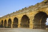 The aqueduct of the Roman period at coast of Mediterranean sea i poster