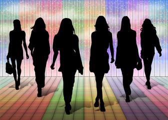 Silhouettes di donne su palco