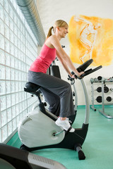 Woman working out on exercise bicycle