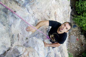 Climber overpassing a difficult point