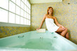 Woman sitting on jacuzzi
