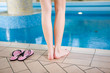 Woman's legs by pool