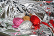 Wrapped Easter eggs inside a glossy silver gift-wrap
