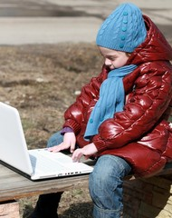 Girl on bench with laptop