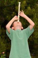 Boy playing a recorder