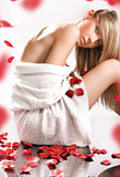 Fototapety Young blond beauty in spa salon, over rose petals