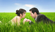 Wedding couple lying on summer meadow over romantic soap bubbles