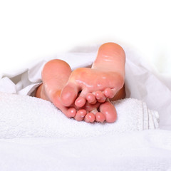 Well-groomed heels of female feet after processing of a skin by