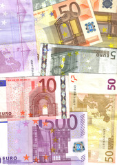euro notes of different value, colorful background