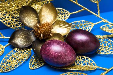 Easter eggs with golden flower
