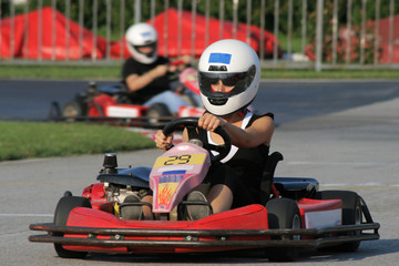 Woman is driving a karting car