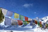 tibetan flag in snowy himalayas poster