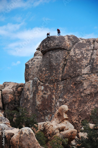Rock Climbers at Top of Peak
