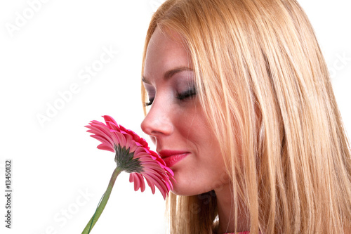 girl smelling a flower