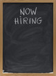 now hiring text on blackboard