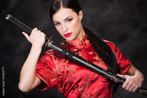 Female samurai holding in her hands a katana