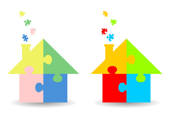 Colourful jigsaw puzzle houses over white background