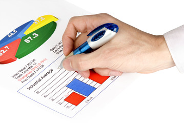 Businessman's hand showing financial diagram