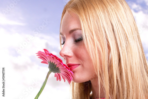 beautiful girl smelling a flower