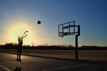 Silhouette of a Teen Boy shooting a Basketball